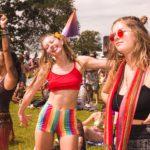 three females at a festival
